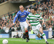 Paul Hartley goes past Kenny Miller during the League Cup final between Rangers and Celtic at Hampden Park -<br /> David Young