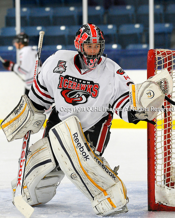NORTH YORK, ON - Oct 6 : Ontario Junior Hockey League Game Action between North York Rangers and Milton Icehawks. Ben Blacker #30 of the Milton Icehawks Hockey Club during the pre-game warm-up.<br /> (Photo by Phillip Sutherland / OJHL Images)
