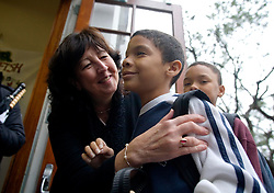 17 Jan, 2006. New Orleans, Louisiana. Post Katrina.<br />  School re-opening. Principal Kathy Riedlinger greets parents and children returning to Lusher Charter School in uptown New Orleans on their first day back since Hurricane Katrina. Kathy lost her home and all her possessions to the storm and is currently living with friends. The school suffered $2 million in damages and has been repaired and returned to service with the help of contractors and parents who have worked tirelessly to re-open the facility to students.<br /> Photo; Charlie Varley/varleypix.com
