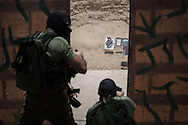 Caliber 3's instructors during a live ammo demonstration. Instructor are former IDF members and has take part to various fights during their career.