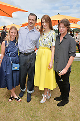 Left to right, KATIE HILLIER, PATRICK GRANT, ROKSANDA ILINCIC and CHRISTOPHER KANE at the Veuve Clicquot Gold Cup Final at Cowdray Park Polo Club, Midhurst, West Sussex on 20th July 2014.