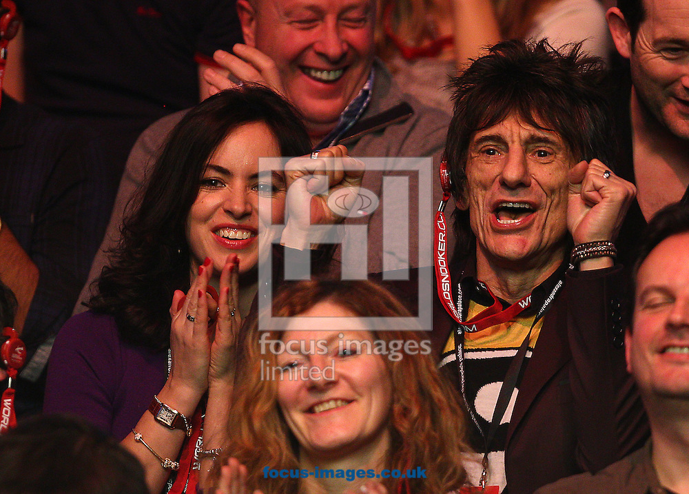 Picture by Paul Terry/Focus Images Ltd +44 7545 642257<br /> 14/01/2014<br /> Ronnie Wood ( R ) with his Wife Sally Humphries during The Masters first round match at Alexandra Palace, London.