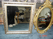 """Bizarre Photos of Mirrors Sold on Craigslist<br /> <br /> Eric Oglander estimates he's spent 700 hours on Craigslist looking for pictures of mirrors. The New York artist has culled through countless advertisements made by regular people throughout the country, and he's saved a few thousand of the most special ones.<br /> <br /> The """"specialness"""" of any particular mirror can be a funny detail, or a beautiful composition, but sometimes it's a heartbreaking moment, reflected by accident. Oglander rarely pays much attention to the words that accompany a Craigslist photo. He finds it means far less than the photo itself. """"Sometimes I think the text must include something like 'Isn't this a crazy photo!?!'' he admits, """"but it never does.""""<br /> ©Eric Oglander /Exclusivepix Media"""