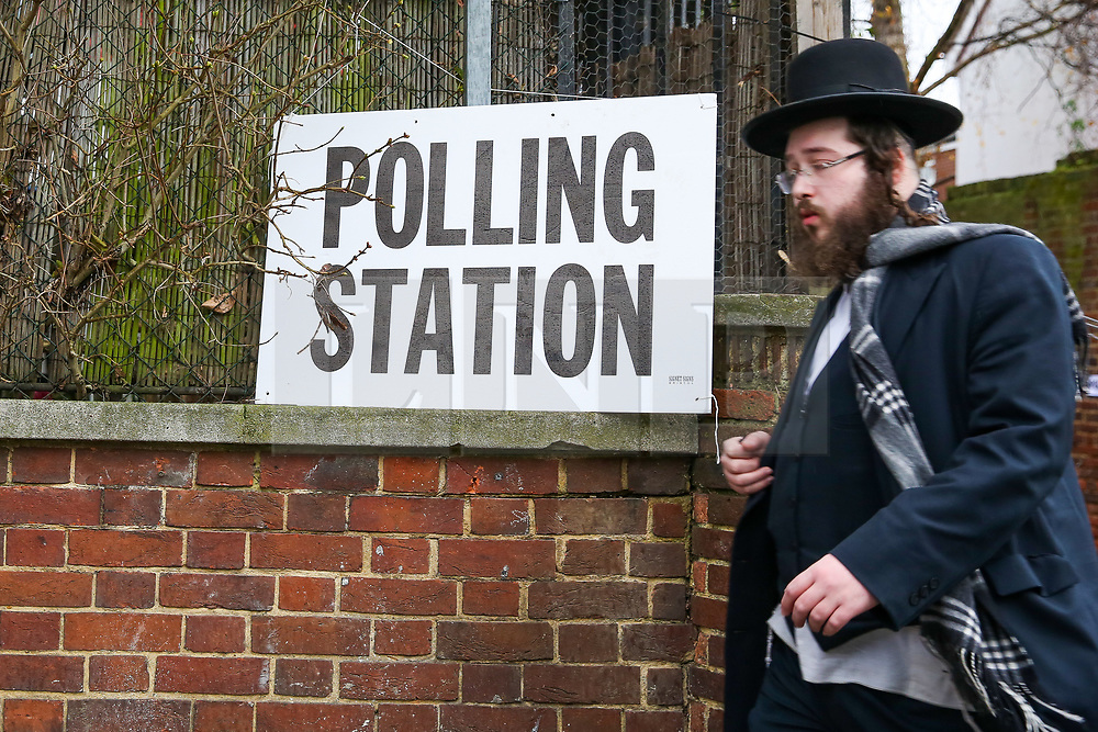 © Licensed to London News Pictures. 12/12/2019. London, UK. An Orthodox Jewish man walks past a polling station in Stamford Hill, north London. Voters are voting today, as the nation decides the next UK Government in the first December General Election since 1923.  Photo credit: Dinendra Haria/LNP