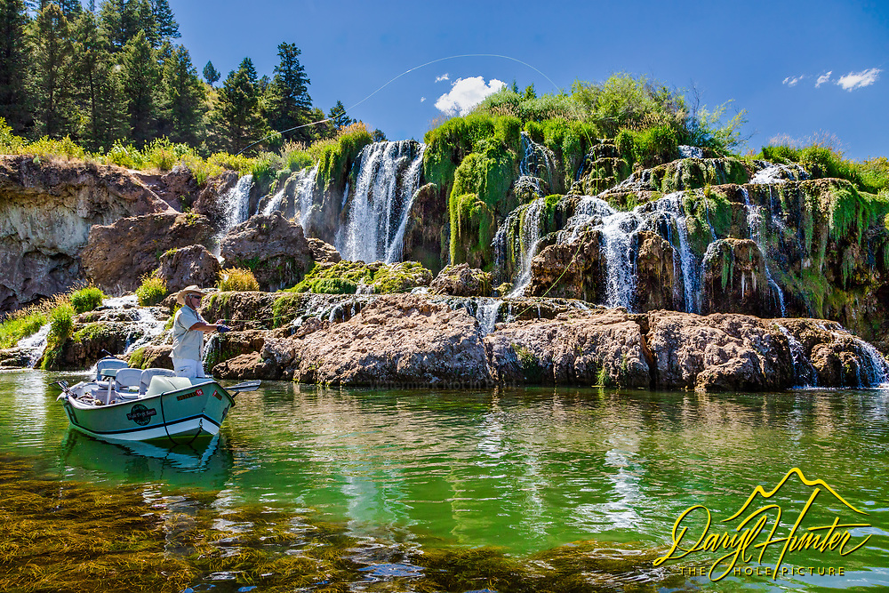Fly-fisherman working the waters of the South Fork of the Snake River below Fall Creek Falls,  Swan Valley Idaho.