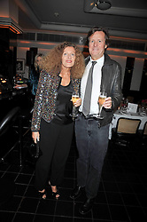 NICOLE FARHI and SIR DAVID HARE at a dinner hosted by Alexandra Shulman editor of British Vogue in association with Net-A-Porter.com to celebrate 25 years of London Fashion Week and Nick Knight held at Le Caprice, Arlington Street, London on 21st September 2009.