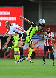 Danny Wright of Cheltenham Town competes with Troy Archibald-Henville of Exeter City for the highball -Mandatory by-line: Nizaam Jones/JMP - 26/08/2017 - FOOTBALL - LCI Rail Stadium - Cheltenham, England - Cheltenham Town v Exeter City - Sky Bet League Two