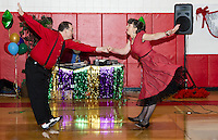Paul Langley from Starry Night Dance Studio along with his partner Gudron Stanton from Summit Health get into the groove for their routine during Dancing With the Community Stars Saturday evening at Laconia Middle School.  (Karen Bobotas/for the Laconia Daily Sun)