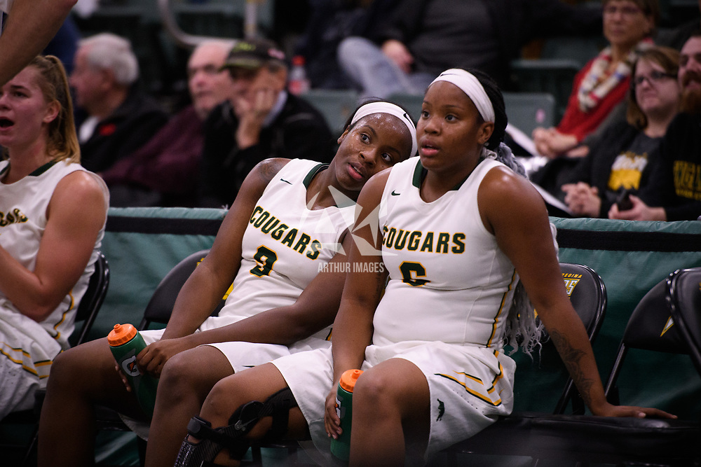 Sisters Kyanna Giles (9) and Kyia Giles (6) of the Regina Cougars look on during the home opener on November  10 at Centre for Kinesiology, Health and Sport. Credit: Arthur Ward/Arthur Images