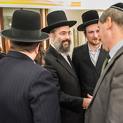 London, UK - 3 December 2014: members of the Orthodox Jewish community welcome Mr Stephen Williams MP, Parliamentary Under Secretary of State for Communities and Local Government, as he visits the Talmud-Torah Yetev-Lev orthodox Jewish school in Hackney, London
