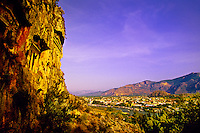 Carian Tombs on cliff, Dalyan River and town of Dalyan in background, Turkey