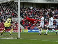 Photo: Andrew Unwin.<br /> Middlesbrough v Bolton Wanderers. The Barclays Premiership. 26/03/2006.<br /> Middlesbrough's Mark Viduka (C) goes close with a spectacular header.