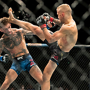 In the main event, TJ Dillashaw (black trunks) retains his bantamweight title belt with a first round TKO of Cody Garbrandt (blue trunks) at UFC 227 held at the Staples Center in Los Angeles on August 4, 2018. Photo by Todd Bigelow for ESPN.