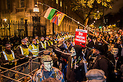 Downing Street is an opportunity for chanting - The annual Million Mask March bonfire night protest started in Trafalgar Square and headed to Westminster where it splintered. The march was organised by Anonymous UK and marchers wore the trademark V for Vendetta, Guy Fawkes masks. The police had placed tight restrictions on the route after trouble last year but, after a brief kettle, seemed happy to let the crowd filter in different directions.