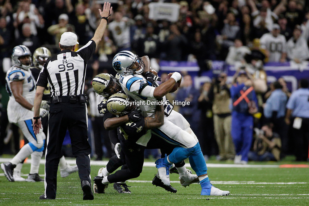 Jan 7, 2018; New Orleans, LA, USA; New Orleans Saints defensive end Cameron Jordan (94) and free safety Vonn Bell (48) combine to sack Carolina Panthers quarterback Cam Newton (1) during the fourth quarter in the NFC Wild Card playoff football game at Mercedes-Benz Superdome. Mandatory Credit: Derick E. Hingle-USA TODAY Sports