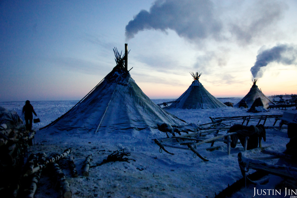 "Tents, or ""Yurts"", belonging to a group of Nenets stand in the Arctic tundra outside the city of Naryan-Mar in the Russian Nenets Autonomous Region."