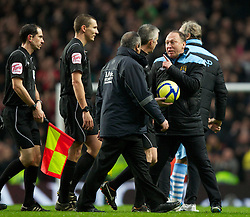 MANCHESTER, ENGLAND - Sunday, January 8, 2012: Manchester City's assistant manager David Platt is having a word with referee Chris Foy after his side's 2-3 defeat to Manchester United after the FA Cup 3rd Round match at the City of Manchester Stadium. (Pic by Vegard Grott/Propaganda)