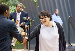 Justice Sotomayor shakes hands with Devon Williams after he asks his question during the question and answer session with students.   2017 Student Convocation with featured honored guest the Honorable Sonia Sotomayor, Associate Justice, United States Supreme Court.  UVI Sports and Fitness Center.  St. Thomas, USVI.  9 February 2017.  © Aisha-Zakiya Boyd