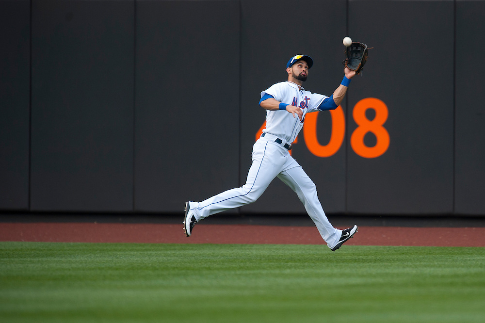 NEW YORK - JULY 16: Angel Pagan #16 of the New York Mets makes a catch in the outfield during the game against the Philadelphia Phillies at Citi Field on July 16, 2011 in the Queens borough of Manhattan. (Photo by Rob Tringali) *** Local Caption *** Angel Pagan