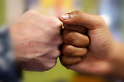 Fist bump.<br /> <br /> <br /> <br /> <br /> ALL RIGHTS RESERVED NOT FOR USE WITHOUT PERMISSION OF PHOTOGRAPHER KAREN PULFER FOCHT