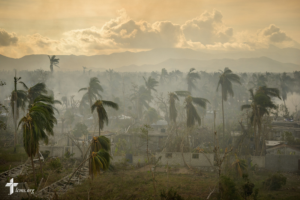 Smoke fills the atmosphere, framing devastation from Hurricane Matthew, on Tuesday, Oct. 11, 2016, in Les Cayes, Haiti. LCMS Communications/Erik M. Lunsford