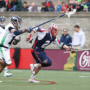 Chris Eck #24 of the Boston Cannons keeps the ball away from Alex Smith #11 of the Chesapeake Bayhawks during the game at Harvard Stadium on April 27, 2014 in Boston, Massachusetts. (Photo by Elan Kawesch)