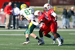 17 November 2012:  Matt Goldsmith and Ezra Thompson double team Zach Vraa during an NCAA Missouri Valley Football Conference football game between the North Dakota State Bison and the Illinois State Redbirds at Hancock Stadium in Normal IL