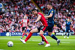 Ollie Clarke of Bristol Rovers takes on Jason Shackell of Lincoln City - Mandatory by-line: Robbie Stephenson/JMP - 14/09/2019 - FOOTBALL - Sincil Bank Stadium - Lincoln, England - Lincoln City v Bristol Rovers - Sky Bet League One