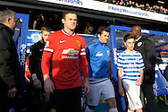 Wayne Rooney, the Manchester United captain and Joey Barton, the QPR captain enter the pitch before k/o. Barclays Premier league match, Queens Park Rangers v Manchester Utd at Loftus Road in London on Saturday 17th Jan 2015. pic by John Patrick Fletcher, Andrew Orchard sports photography.