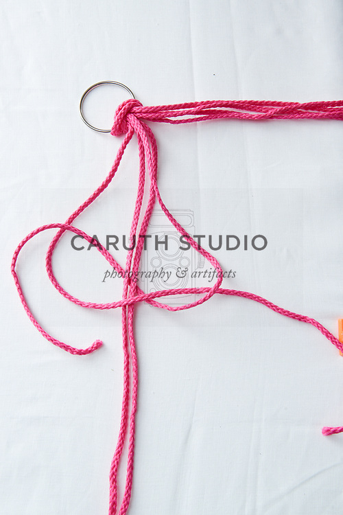 Step two to make a square knot with macrame cord