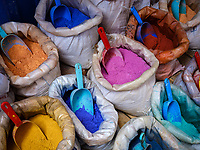 CHEFCHAOUEN, MOROCCO - CIRCA MAY 2018:  Bags of powdered fabric dye at the Medina in Chefchaouen. The dyes are used by Moroccan rug and textile makers.