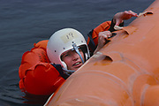 "The first female NASA astronauts qualify in Water Survival School at Turkey Point, Florida. NASA Astronaut candidate Anna L. Fisher participates in a water rescue exercise during the US Air Force Water Survival School. Fisher's classmates include Sally K. Ride, Shannon W. Lucid, Kathryn D. Sullivan, Margaret ""Rhea"" Seddon and Judith A. Resnik."