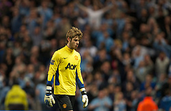 MANCHESTER, ENGLAND - Monday, April 30, 2012: Manchester United's goalkeeper David de Gea walks off dejected after losing 1-0 to Manchester City during the Premiership match at the City of Manchester Stadium. (Pic by David Rawcliffe/Propaganda)