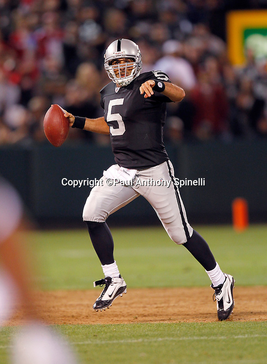 Oakland Raiders quarterback Bruce Gradkowski (5) rolls out while directing traffic and looking to pass during the NFL preseason week 3 football game against the San Francisco 49ers on Saturday, August 28, 2010 in Oakland, California. The 49ers won the game 28-24. (©Paul Anthony Spinelli)