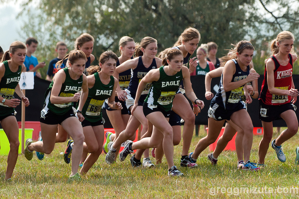 The start  (L to R: Kaittlyn Schut, Brittany Rawlins, Megan Dupree, Brooke Rawlins, Jessica Anstee, and Annalisa Jones) of the Bob Firman XC Invitational Girls D-1 Varsity race at Eagle Island State Park in Eagle, Idaho on September 22, 2012.