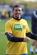 AFC Wimbledon striker Cody McDonald (10) warming up during the EFL Sky Bet League 1 match between AFC Wimbledon and Plymouth Argyle at the Cherry Red Records Stadium, Kingston, England on 21 October 2017. Photo by Matthew Redman.