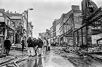 Main Street, Portrush, Co Antrim, N Ireland - mopping up after an overnight bombing blitz by the Provisional IRA. The IRA's 8 bombs were at the height of the popular resort's holiday season. 4th August 1976. 197608040336w<br />