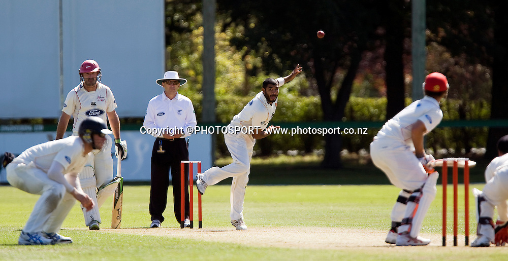 Jeetan Patel bowling for Wellington, Shannon Stewart is at the non strickers end with Reece Young facing for Canterbury. Canterbury Wizards v Wellington Firebirds, Plunket Shield Game held at Mainpower Oval, Rangiora, Wednesday 16 March 2011. Photo : Joseph Johnson / photosport.co.nz