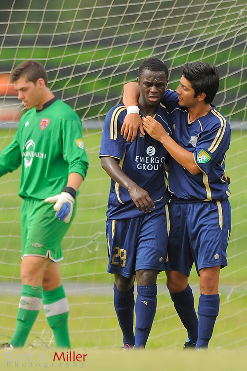 Austin Aztex midfielder Kekuta Manneh (28) and forward Khiry Shelton (20) celebrates a penaly kick score during their 4-2 loss to Orlando City in the PDL Southern Conference Championships final at Trinity Catholic High Schooll on July 22, 2012 in Ocala, Florida. ..©2012 Scott A. Miller