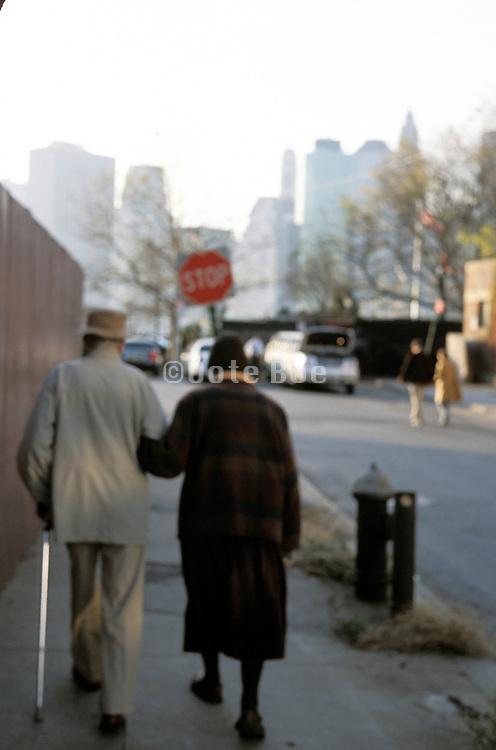 Elderly couple walking together