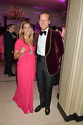 JAKE & SAMIRA PARKINSON-SMITH at the QBF Spring Gala in aid of the Red Cross War Memorial Children's Hospital hosted by Heather Kerzner and Jeanette Calliva at Claridge's, Brook Street, London on 12th May 2015.