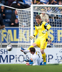 Falkirk's keeper Michael McGovern saves from Morton's David O'Brein.<br />