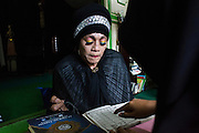 A transgender woman learns to read Koran during a weekly gathering at the Koran School in Yogyakarta, Indonesia. The Koran School has to be shut down after a group of Muslim hardliner demand the closure of the activity of the Koran school because according to them in Islam transgender is not exist.
