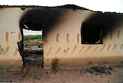 A burned out roundaval hut in the hamlet of Shoboshobane, on the KwaZulu/Natal South Coast.  On Christmas Day, the ANC village was attacked by Inkatha neighbours killing more than 20 residents, and driving the rest into refugee camps.  December 26th, 1995.