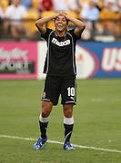ATLANTA, GA - AUGUST 06:  Forward Marta #10 of the Western NY Flash reacts after scoring her second goal of the game during the Women's Professional Soccer game between the Atlanta Beat and the Western New York Flash at Kennesaw State University Soccer Stadium on August 6, 2011 in Atlanta, Georgia.  The Flash beat the Beat 2-0.  (Photo by Mike Zarrilli/Getty Images)