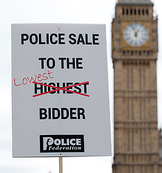 © Licensed to London News Pictures. 10/05/2012. LONDON, UK. UK Policemen hold banners at Parliament Square. Off duty police officers take part in a Police Federation protest over proposed changes to pay and conditions. Tony Melville, the outgoing chief constable of Gloucestershire Police, was among the marchers. Photo credit: Matt Cetti-Roberts/LNP