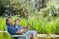 Man and son fishing together countryside