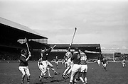 25/04/1965<br /> 04/25/1965<br /> 25 April 1965<br /> National Hurling League Semi-Final: Kerry v West Meath at Croke Park, Dublin. <br /> M. Hennesy (Kerry forward) jumps to take possession; but the ball slips past his stick, which rams down the arm of West Meath's defender, J. Power. While S. Holdwright (West Meath) and J. Barry (Kerry) await the outcome. Goalie, J. Nooney stopped the action.