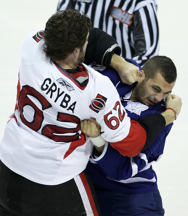 London, ONT.: September 14, 2010 --  Leafs' rookie Mike Liambas fights with Ottawa Senators rookie Eric Gryba during their teams final game of the 2010 NHL Rookie Tournament at the John Labatt Centre in London, Ontario, September 14, 2010. The Senators defeated the Leafs 3-2.<br /> (GEOFF ROBINS for National Post)
