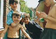 Six year old Lee flexing his muscles, St Werburghs, Bristol, UK, 2002